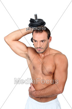 Young Man With Dumbell Stock Photo