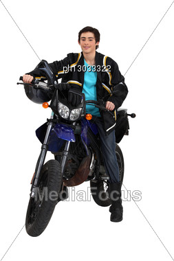 Young Man With First Motorcycle Stock Photo