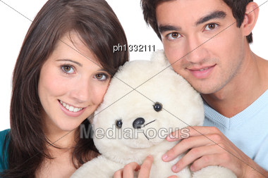 Young Man And Woman With A Teddy Bear Stock Photo