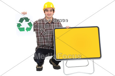 Young Manual Worker With Recycle Logo And Blank Road Sign Stock Photo