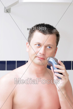 Young Men Shaving In Bathroom Stock Photo
