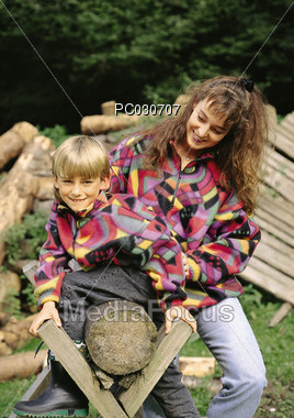 Young Mother with Son Outdoors Stock Photo