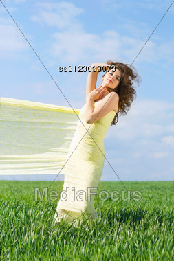 Young Nice Woman Wrapped In Yellow Cloth Stock Photo