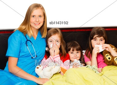 Young Pediatrician Taking Care Of Her Sick Little Patients Stock Photo