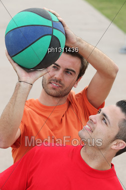 Young People Playing Basketball Stock Photo