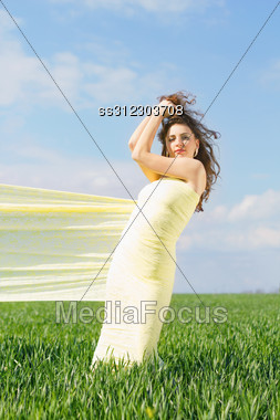 Young Perfect Woman Wrapped In Yellow Cloth Stock Photo