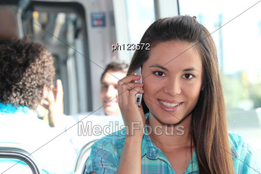 Young Person On Mobile Phone Stock Photo