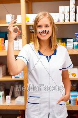 Young Pharmacist Showing A Gesture Of Satisfaction Of Her Work Stock Photo