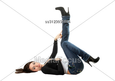 Young Playful Brunette Lies On Her Back Stock Photo