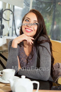 Young Playful Lady Posing In A Cozy Restaurant Stock Photo