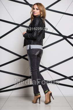 Young Pretty Blond Woman Wearing Black Jacket And Jeans Stock Photo
