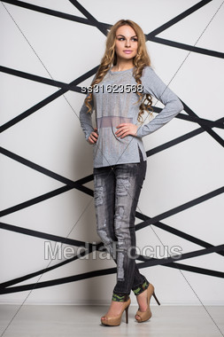 Young Pretty Blond Woman Wearing Gray Blouse And Jeans Stock Photo