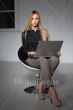 Young Pretty Blonde Wearing Business Suit Posing With Laptop Stock Photo