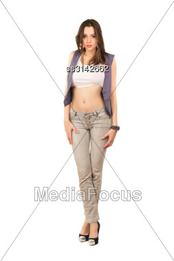 Young Pretty Frightened Brunette In Grey Jeans And Top. Isolated On White Stock Photo
