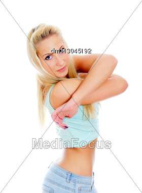 Young Pretty Girl Taking Off Her Top. Isolated On White Stock Photo