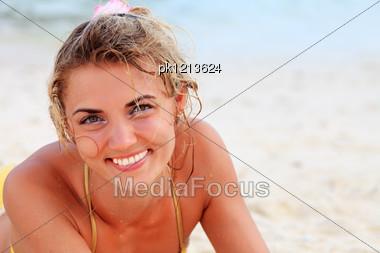 Young Pretty Woman In Bikini At The Beach Stock Photo