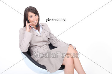 Young Receptionist With Headset Stock Photo