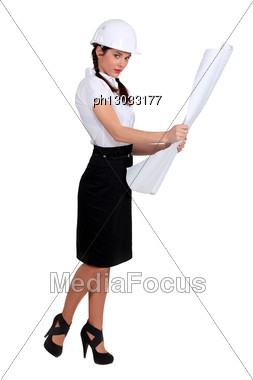 Young Sexy Architect Holding Plans Stock Photo