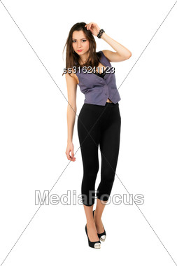 Young Sexy Brunette Wearing Tight Black Leggings And Grey Vest. Isolated On White Stock Photo