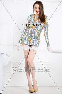 Young Smiling Brunette Wearing Frank Dress And White Stockings Stock Photo