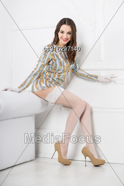 Young Smiling Woman Wearing Frank Dress And White Stockings Stock Photo