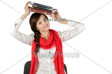 Young Student Girl With Her Books In Hand At Head, Smiling And Looking At The Camera Stock Photo
