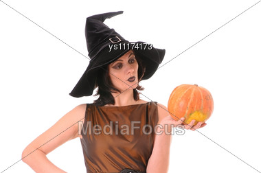 Young Witch With Pumpkin Stock Photo