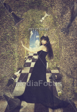 Young Woman As Black Chess Queen. Fairy Tail Image. Old Style Stock Photo