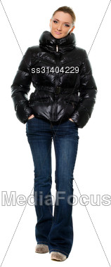 Young Woman In A Blue Jeans And Black Jacket Stock Photo