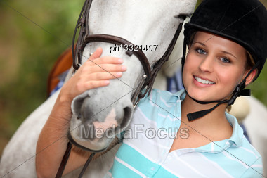 Young Woman Caressing Her Horse Stock Photo