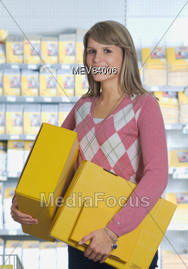 Young Woman Carrying Packages Stock Photo