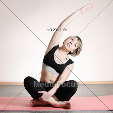 Young Woman Doing Yoga Exercises Stock Photo