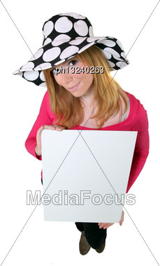 Young Woman In A Floppy Hat Holding A Board Left Blank For Your Message Stock Photo