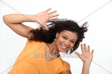Young Woman Holding Her Hands Up Stock Photo