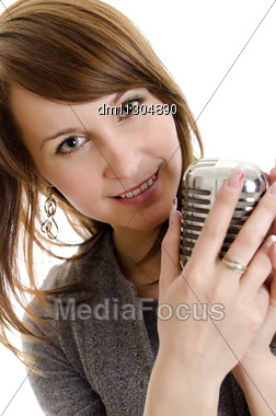 Young Woman Holding A Retro-microphone. Isolated On White. Stock Photo
