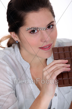 Young Woman With A Huge Bar Of Chocolate Stock Photo