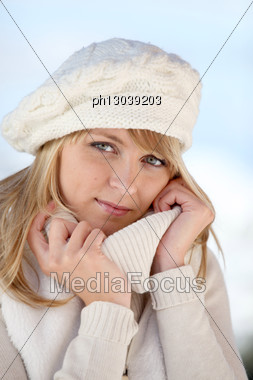 Young Woman In A Cream Jumper And Hat Stock Photo