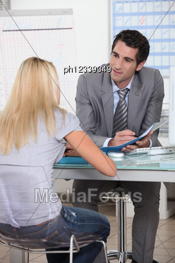 Young Woman In Interview With Trainer Stock Photo