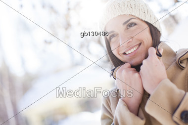 Young woman in the winter park Stock Photo