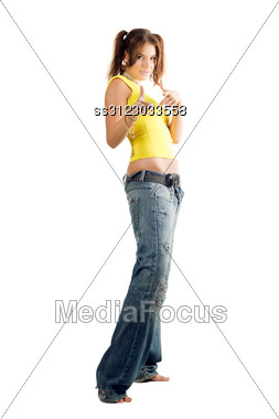 Young Woman In Wide Jeans Gesturing. Stock Photo
