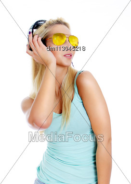 Young Woman Listening Music In Headphones. Isolated On White. Stock Photo