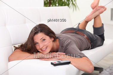 Young Woman Relaxing On The Couch Stock Photo