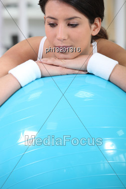 Young Woman Resting On A Gym Ball Stock Photo