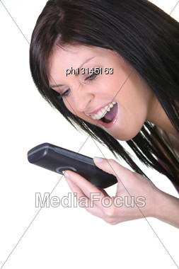 Young Woman Shouting At Her Mobile Phone Stock Photo