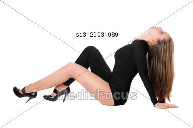 Young Woman Sitting In A Black Tight-fitting Body Suit Dance Stock Photo