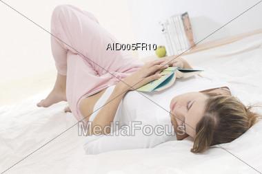 Young Woman Sleeping Stock Photo