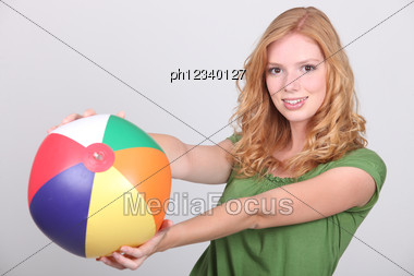 Young Woman With A Beach Ball Stock Photo
