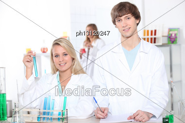 Young Woman And Young Man In A Laboratory Stock Photo