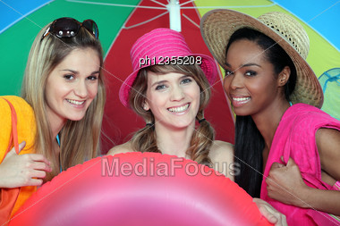 Young Women At The Beach Together Stock Photo