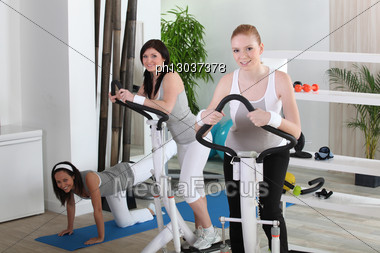 Young Women Using Gym Equipment Stock Photo
